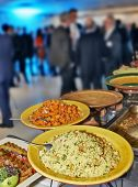 picture of catering service  - Catering service with lot of blurred people in background - JPG