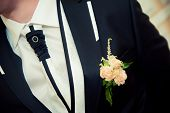 image of boutonniere  - pink boutonniere for the black groom - JPG