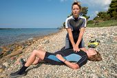 stock photo of prone  - Two Female scuba divers doing rescue training - JPG