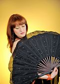 Beautiful Belly Dancer With Big Black Fan