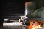foto of furnace  - the Russian bath on black with the kindled furnace - JPG