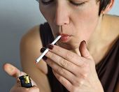 stock photo of cigarette lighter  - Beautiful woman with a cigarette - JPG