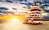 pic of lifeguard  - Miami South Beach sunrise with white and red lifeguard tower - JPG