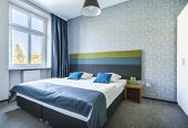 image of motel  - Big twin bed in modern blue hotel apartment - JPG
