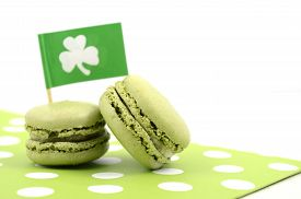 picture of shamrocks  - Happy St Patricks Day green macaron cookies with shamrock flag on white table - JPG