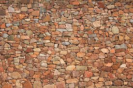 stock photo of mortar-joint  - Natural stone wall made of quarry stones - JPG