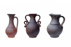 stock photo of loamy  - Vintage Pottery isolated over a white background - JPG