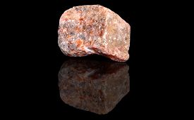 picture of calcite  - Orange calcite  raw mineral stones with reflection on black background - JPG