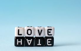 stock photo of hate  - Love and Hate text concept on white and black dices - JPG