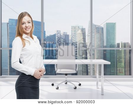 Portrait Of A Beautiful Business Lady In A Contemporary Office With Singapore Panoramic View.