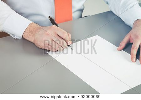 Close Up Of Businessman's Hand Intending To Write A Document, Petition Or Claim. A Concept Of Drafti