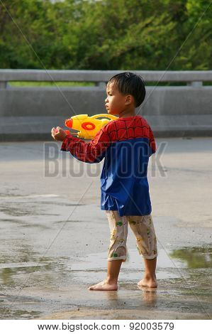 The Boy In A Water Fight Festival At Chiangmai , Thailand