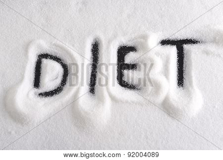Diet Word Written With Finger On Pile Of Sugar In Dieting And Healthy Nutrition Concept