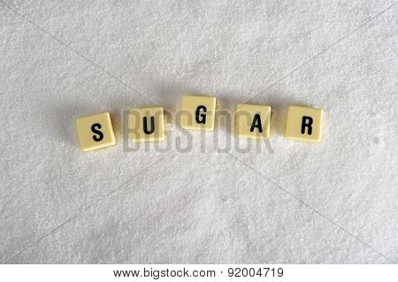 Sugar Block Letters In Crossword Over Sugar Pile Isolated On Grainy White Sugar Texture In Sweet Foo