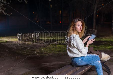 Young woman using tablet outdoor smiling.