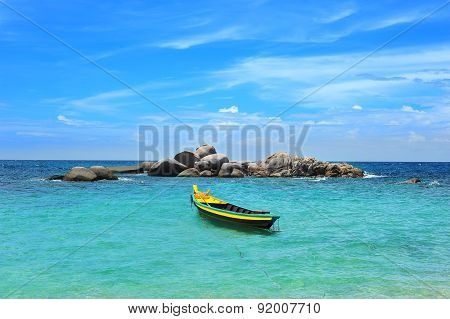 Yellow boat in the turquoise sea
