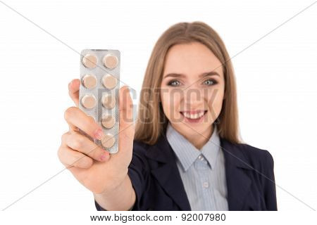 Young Businesswoman Holding A Pill For A Headache