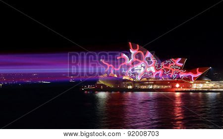 Colourful Red And Blue Light Beams On Sydney Opera House