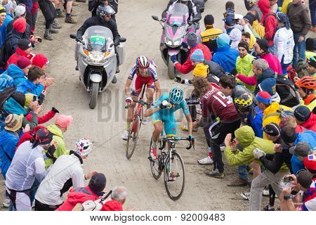 Tour Of Italy: Cyclists Racing On Mountain Dirt Road