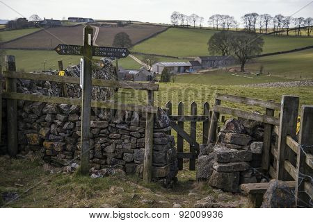 Public Footpath Signposts In Landscape In Peak District Uk On Sunny Day