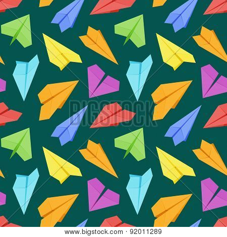 Seamless pattern with colored paper planes against the dark-green background