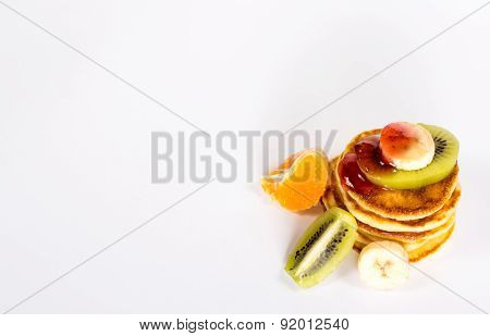 isolated stack of pancake with fruits