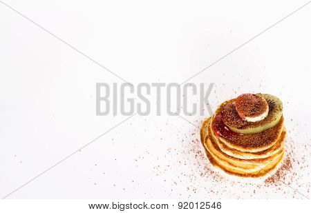 isolated sweet pastries - stack of pancake with cocoa and fruits