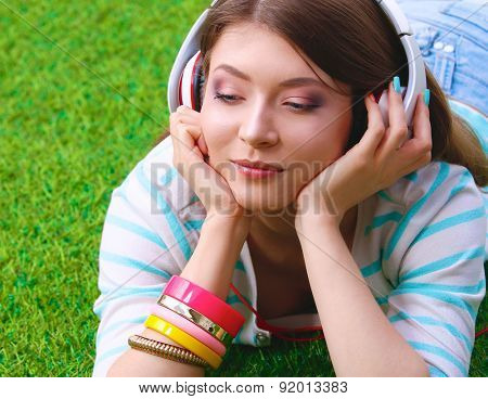 Young woman listening to the music.