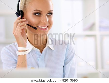 portrait of a customer service agent sitting at office.