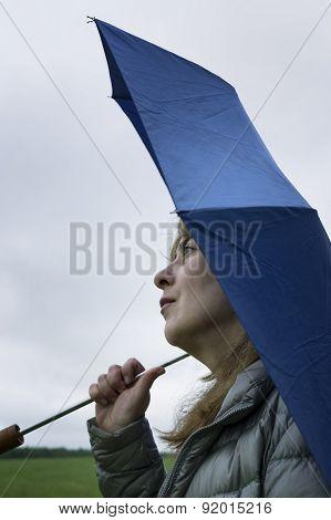 Woman Waiting For The Rain