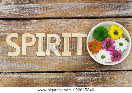 Spirit written with wooden letters and Santini flowers