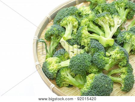Pile of Broccoli slice in bamboo tray on white background