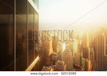 Cityscape Reflected In The Glass Of An Office Building At Sunset