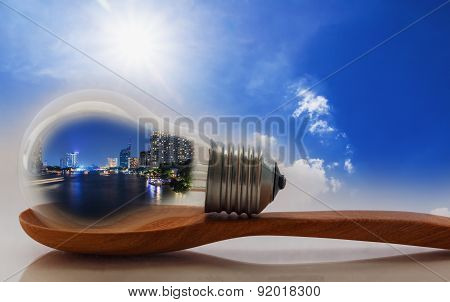 Concept ,lighting  Of Building In Light Bulb