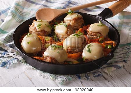 Meat Balls Baked With Cheese And Vegetables In The Pan.