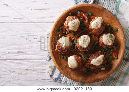 Meatballs With Cheese In Bowl. Horizontal Top View