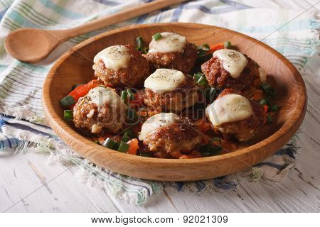 Meat Balls With Cheese And Vegetables In A Wooden Bowl