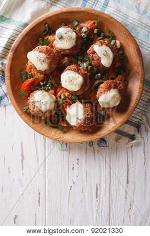Meatballs With Cheese In Bowl. Vertical Top View