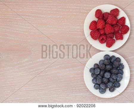 Raspberry And Bilberry On The Plates