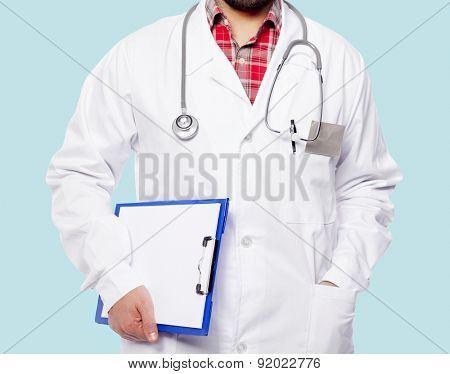 Male doctor in a blue background