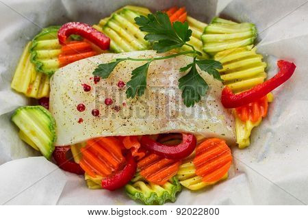 Cooking fish with vegetables in parchment. Healthy eating, diet