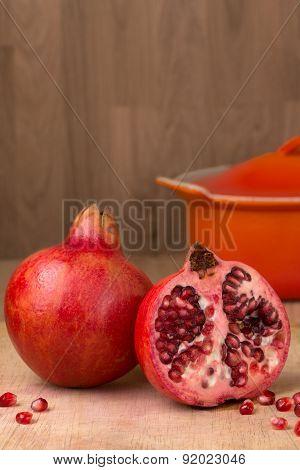 Whole & Cut Pomegranate On Wood Chopping Board Punica Granatum