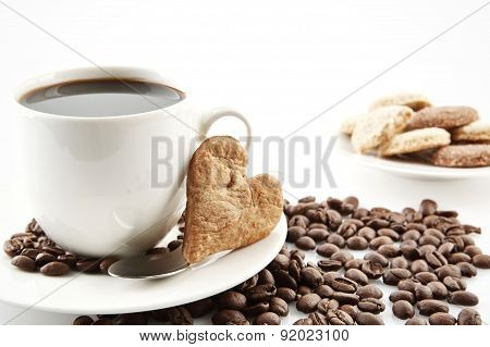 Cup Of Coffee With Cookie Heart At Breakfast