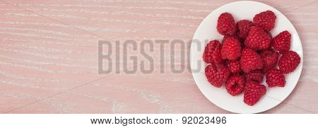 Raspberry On The White Plate