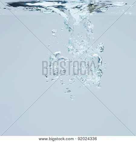 Closeup of blue bubbles underwater