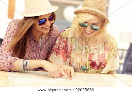 A picture of two friends checking on map