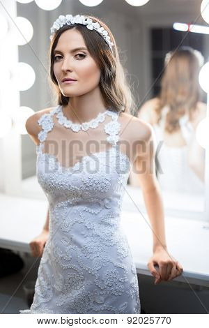 Fashion bride in a studio near the dressing room