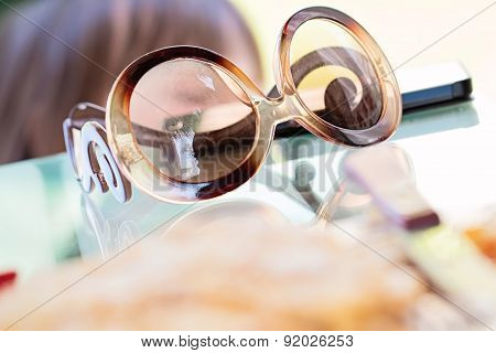 Eye Fashioned Glasses On Glass Table