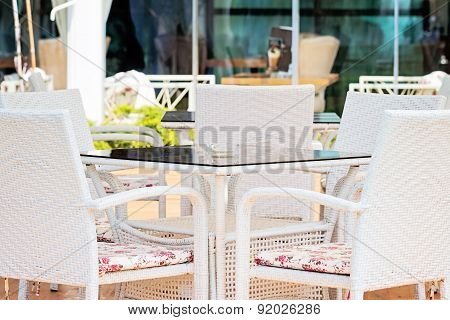 White Chairs And Table In Restaurant