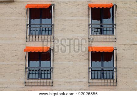 Facade Of Building With Orange Awning